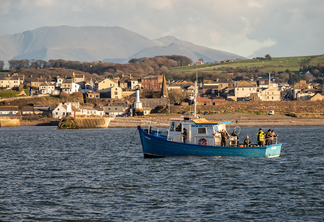 Photo of Venture West charter fishing boat on the Solway Firth with Maryport in the background
