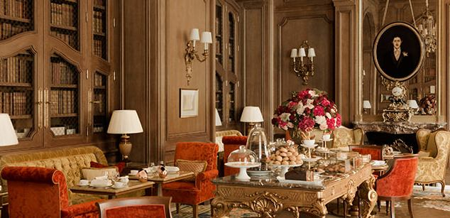 Warm paneling in dining area of renovated Ritz Paris
