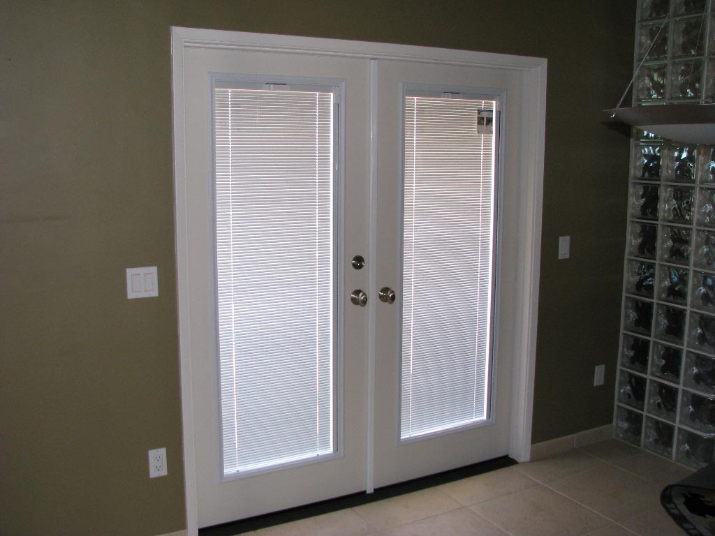 Patio Doors Among Internal Blinds Applying White Color