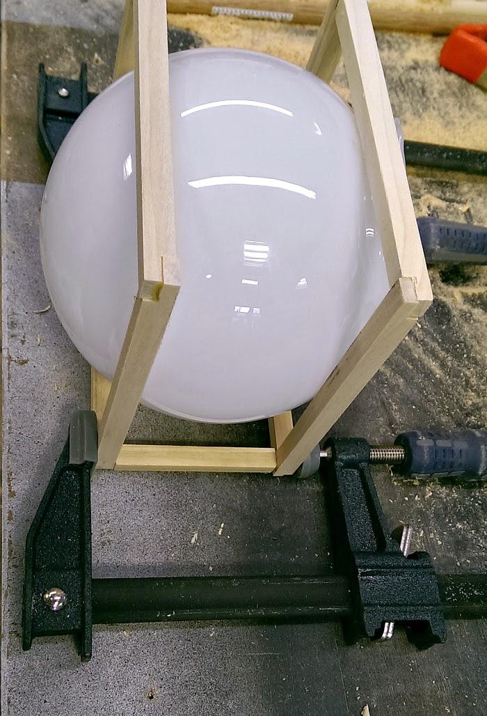 DIY upcycled light globe air plant hanger
