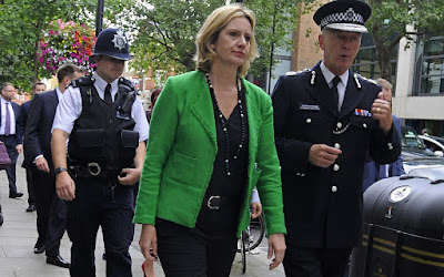 Amber Rudd and policemen