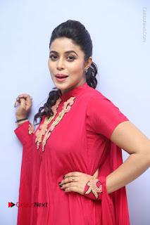 Actress Poorna Latest Stills in Red Dress at Rakshasi First Look Launch  0154.JPG