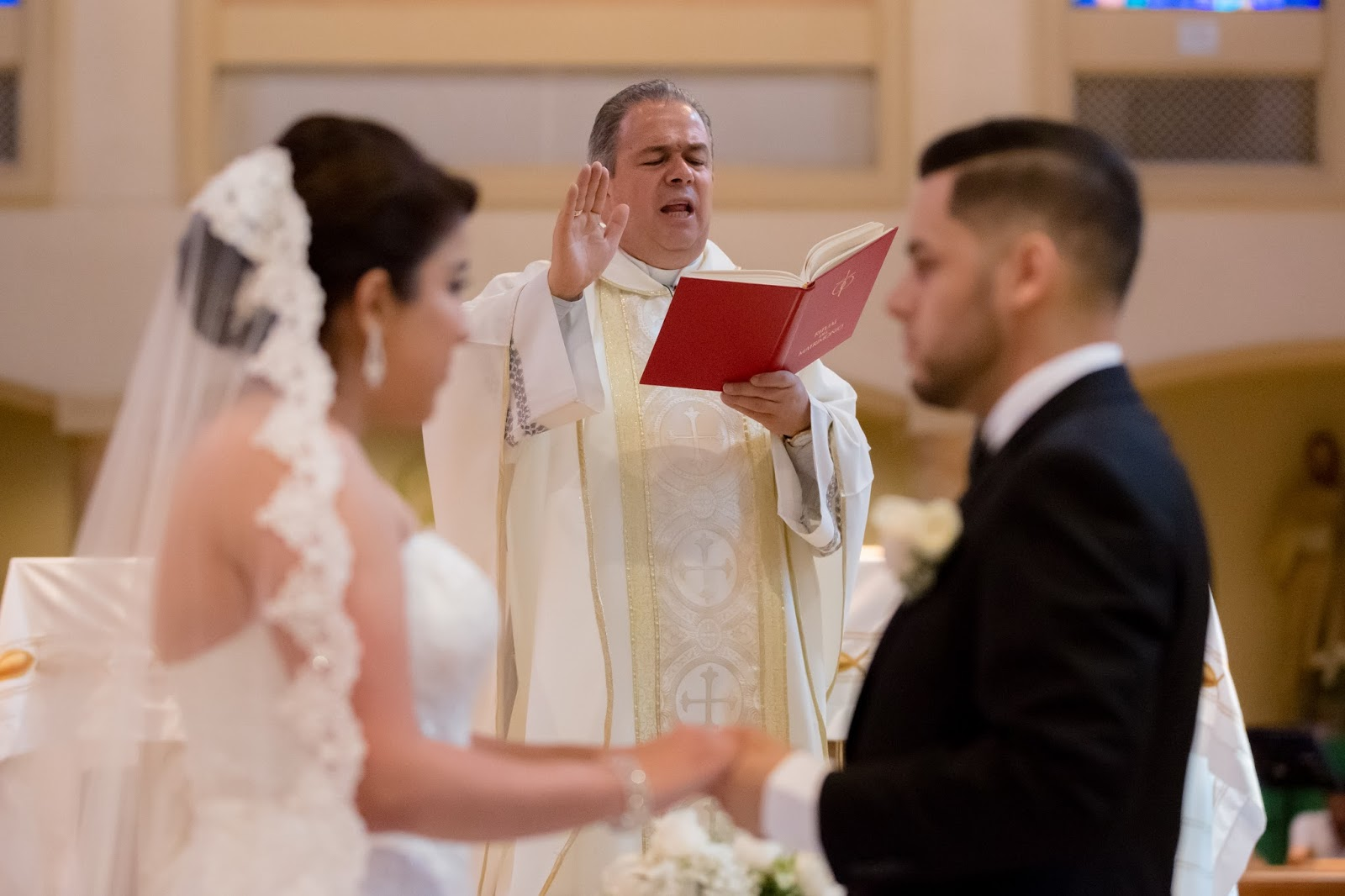 Priest leading Bride and Groom in Vows