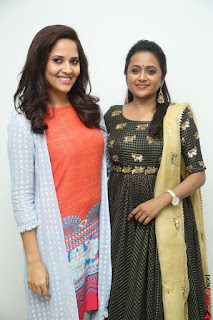 Actress Suma in Black Salwar Suit and Anusuya in orange Dress at winner movie press meet part 1 February 2017 (18).JPG