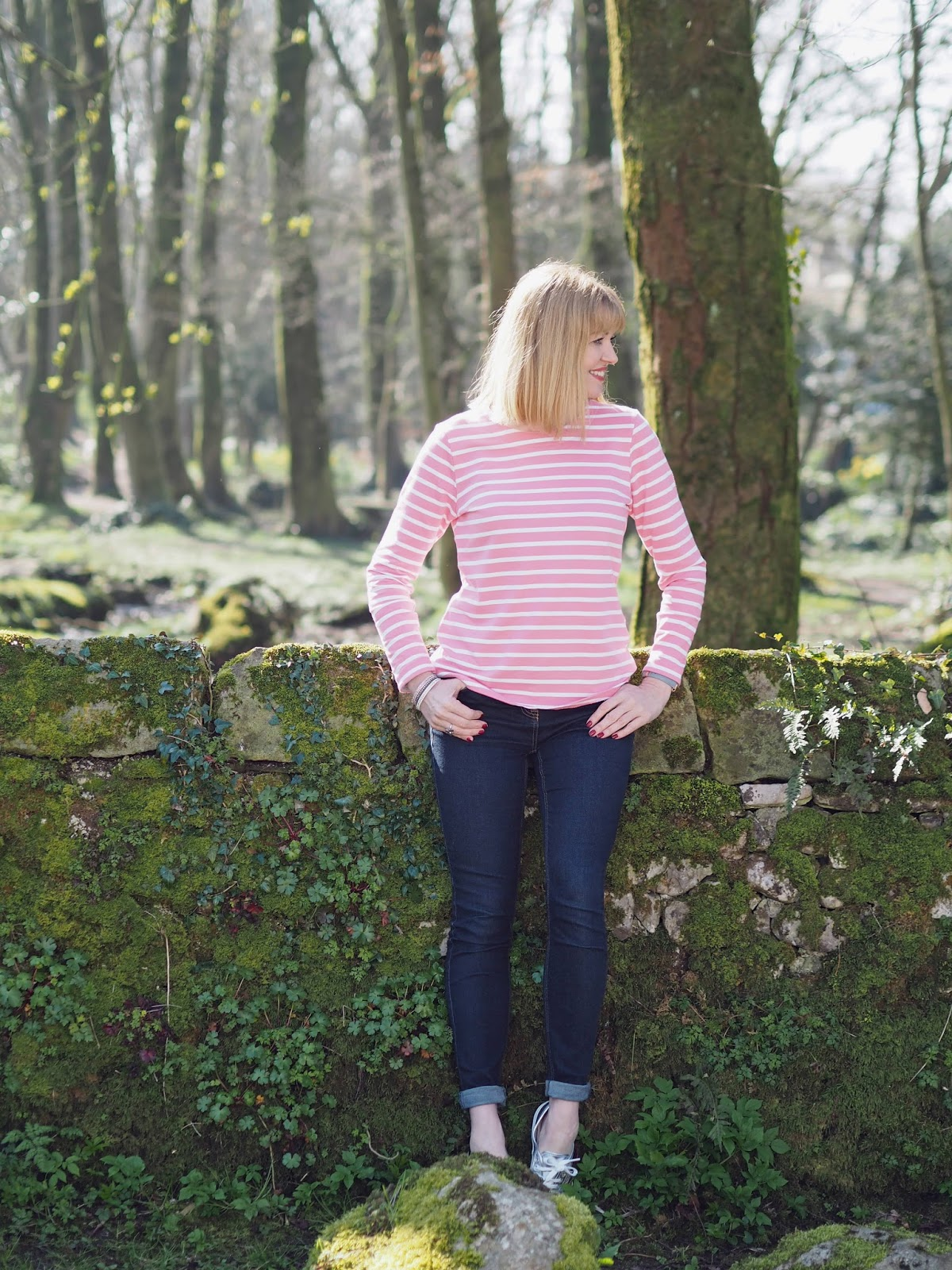 Full length image of What Lizzy Loves wearing pink and white striped breton top by Tulchan with skinny jeans and silver Superga pumps