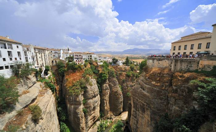 Ronda is a city in the Spanish province of Málaga. It is located about 100 kilometres (62 mi) west of the city of Málaga with a population of approximately 35,000 inhabitants. Ronda was first settled by the early Celts, who, in the 6th century BC, called it Arunda. Later Phoenician settlers established themselves nearby to found Acinipo, known locally as Ronda la Vieja, Arunda or Old Ronda. The current Ronda is however of Roman origins, having been founded as a fortified post in the Second Punic War, by Scipio Africanus