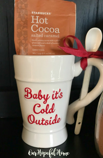Baby It's Cold Outside mug with attached spoon and Starbucks salted caramel powdered cocoa mix