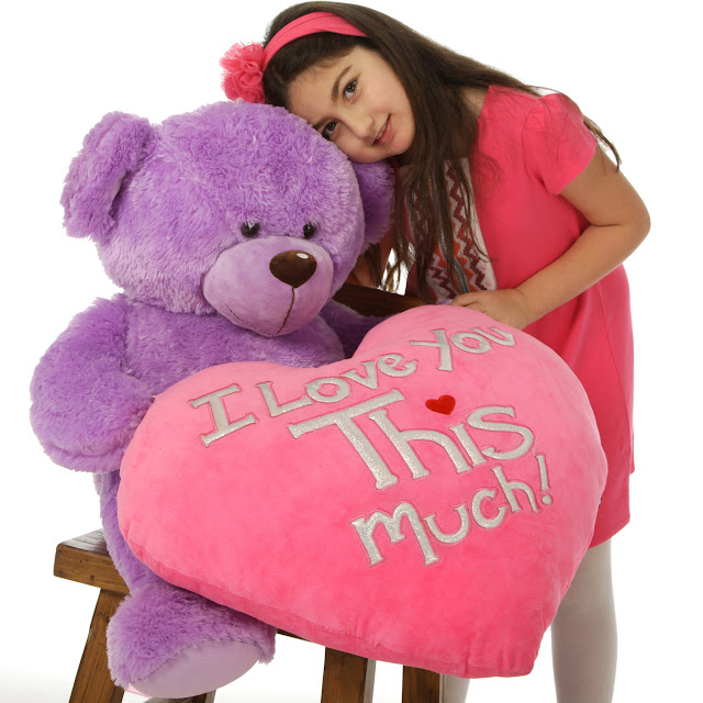 purple teddy bear and a giant pink heart