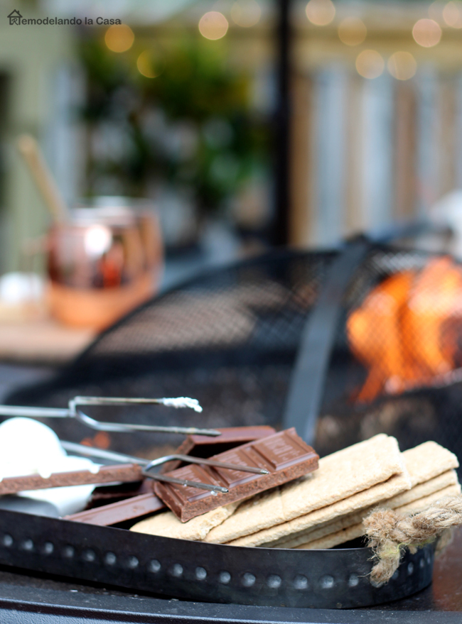 fire pit on deck with s'mores and hot tea