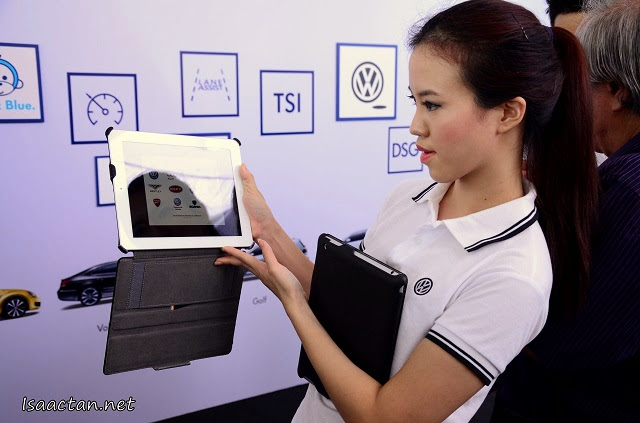 Interacting with the various Volkswagen features via iPads at one of the stations