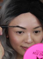 Apply brow mascara Benefit Cosmetics Gimme Brow #medium/deep to make your brow look fuller and thicker