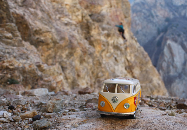 yellow van and rock climber in Rock Canyon