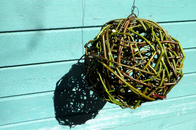 DIY Willow Ball Garden Decoration. Willow balls are the perfect decoration to hang in a tree in the garden. It's not a completely solid ball so light will show through it making a lovely silhouette.