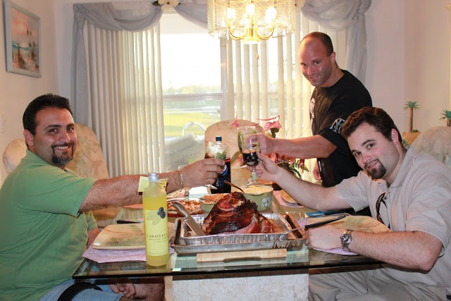 The family eating honey spiral cut ham and side dishes for Easter