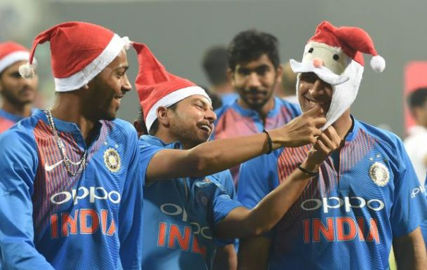 Dhoni, Kuldeep and Hardik sharing a light moment.