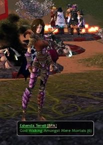 "A female looking game character dressed in pink armour stands with the title panel beneath their feet. It gives their name and guild affiliation and the title, ""God Walking Amongst Mere Mortals""."