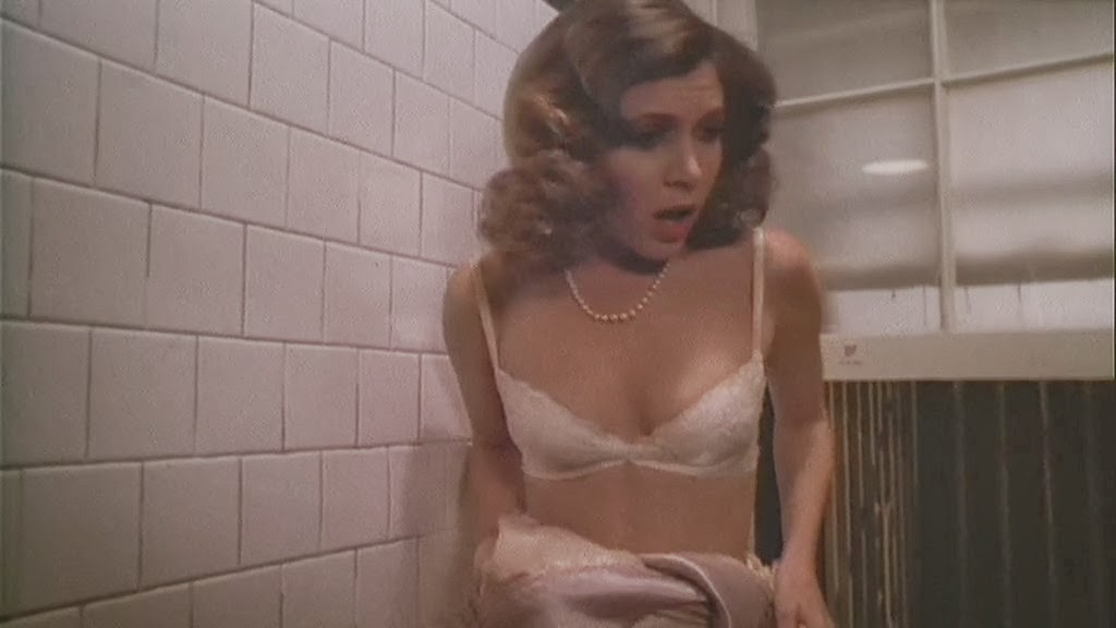 carrie fisher in white bra and pearl necklace