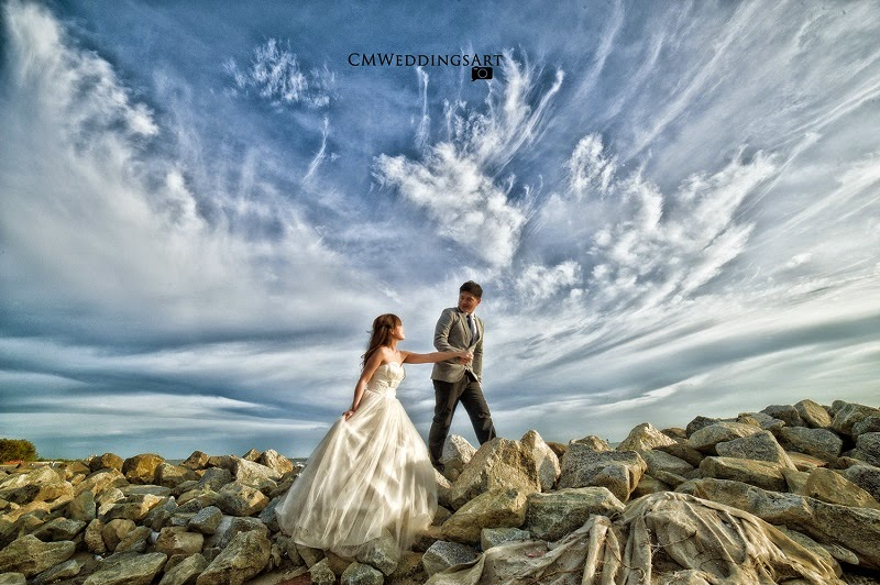 cloudy rocks walking couple