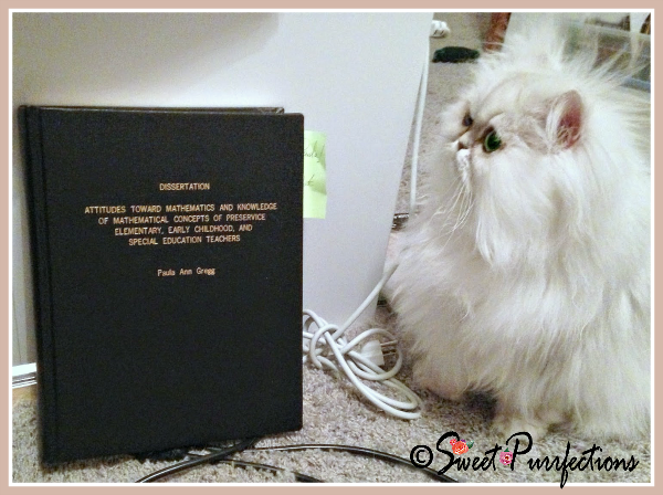 Brulee, pictured with dissertation, says Cat Ladies are smart!
