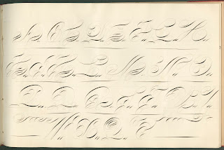 A curving, heavily stylized alphabet.