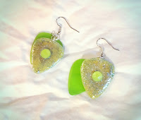 Glittery guitar pick earrings with yellow gems and green transparent picks
