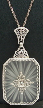 Art Deco camphor glass, diamond, and white gold filigree necklace.