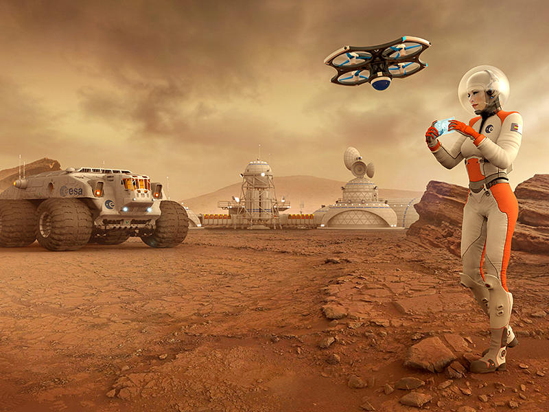 Female astronaut flying a drone near a human base on Mars by Vanessa Reig