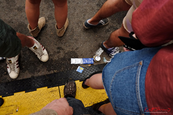 Condoms, the shoes, the empty cans, the protective floor mating. Harbour Life Music Festival Sydney 2016. Photographed by Kent Johnson for Street Fashion Sydney.