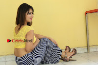 Cute Telugu Actress Shunaya Solanki High Definition Spicy Pos in Yellow Top and Skirt  0395.JPG