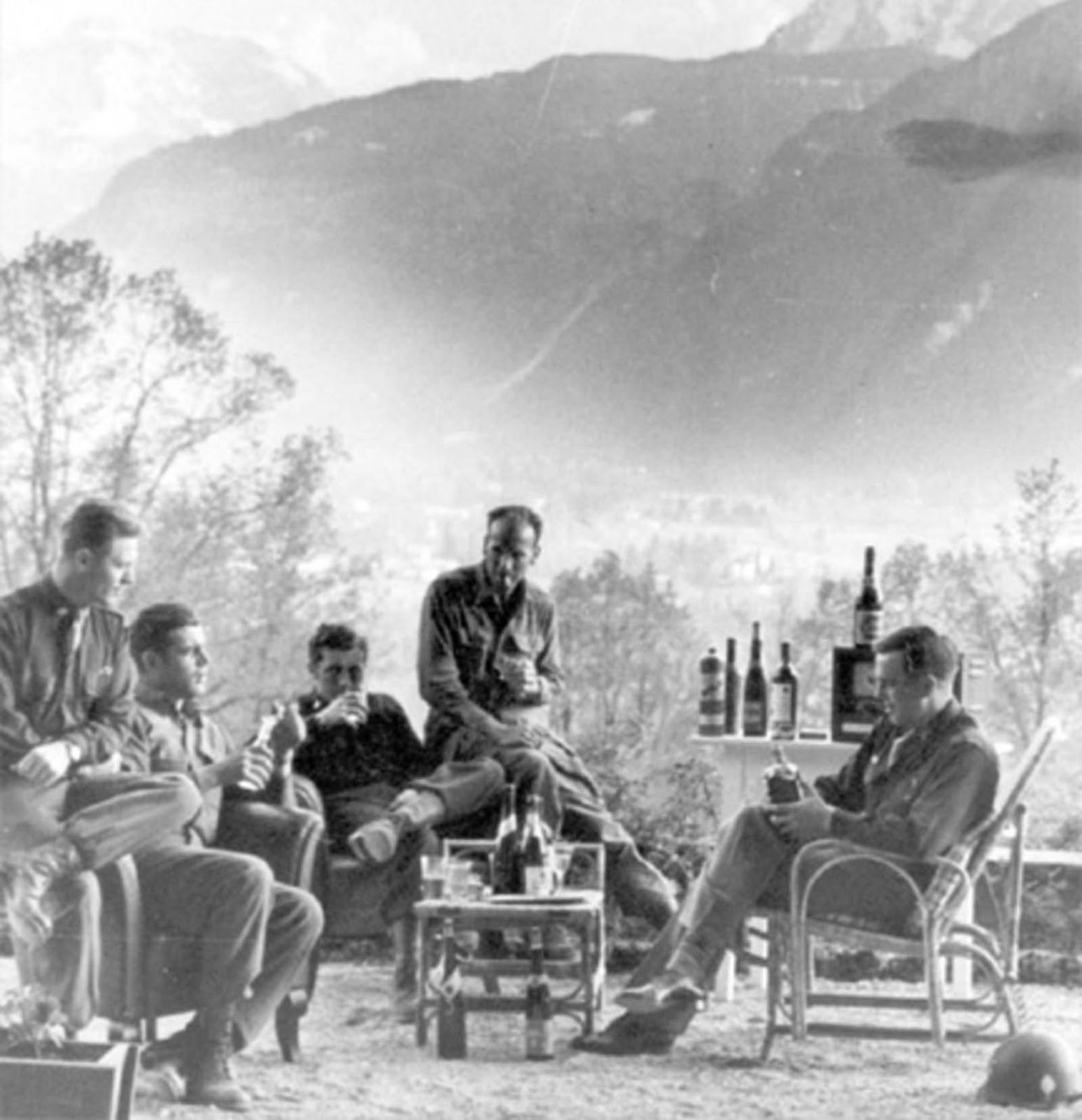 (L to R) Major Winters, Lewis Nixon, Harry Welsh, and two other battalion staff members, celebrating VE-Day in Berchtesgaden, Germany.