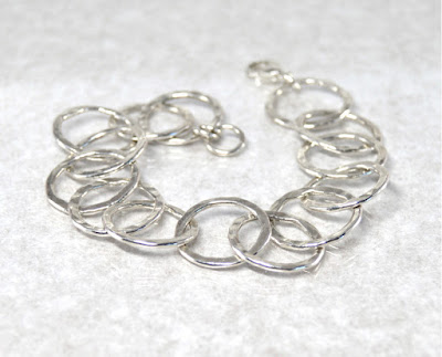 http://brackendesigns.com/product/sterling-silver-textured-circle-links-bracelet