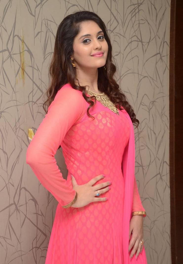 Surabhi Stills In Orange Dress At Movie Success Meet