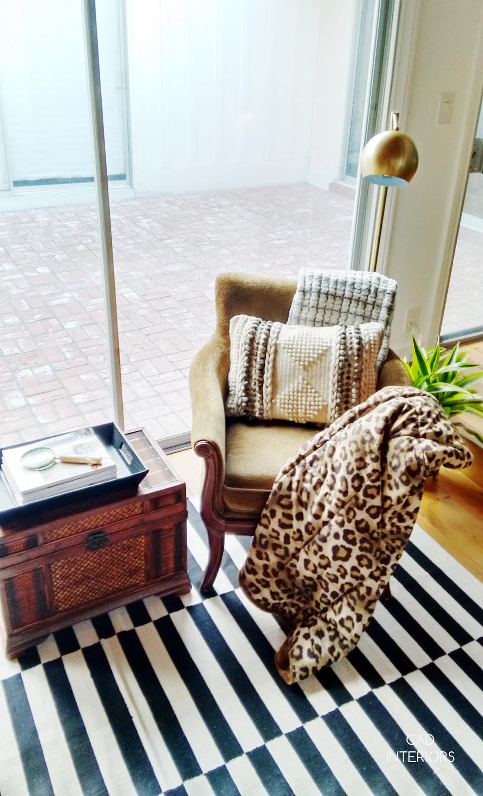 CAD INTERIORS family room world market striped area rug woven storage ottoman table target brass globe floor lamp