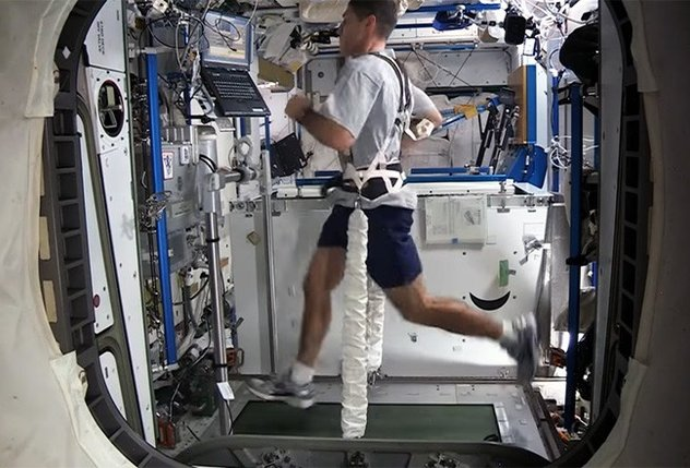 Man on treadmil in space station