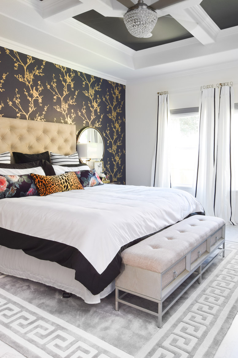 Gorgeous black, white and gold master bedroom suite.