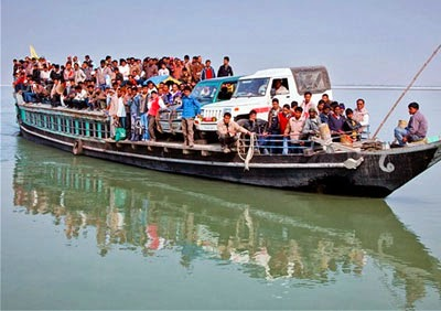 an indian ferry carrying people of assam in bramputtra river