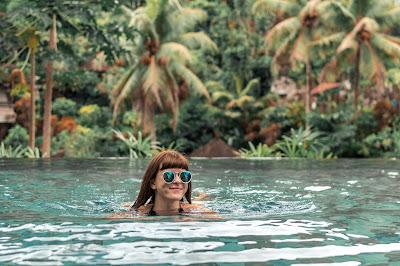 woman swimming in stunning tropical pool