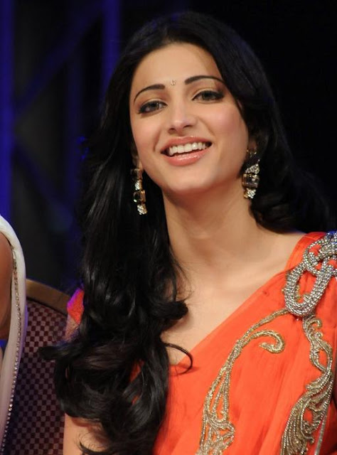 Shruti Hassan Photos In Orange Saree
