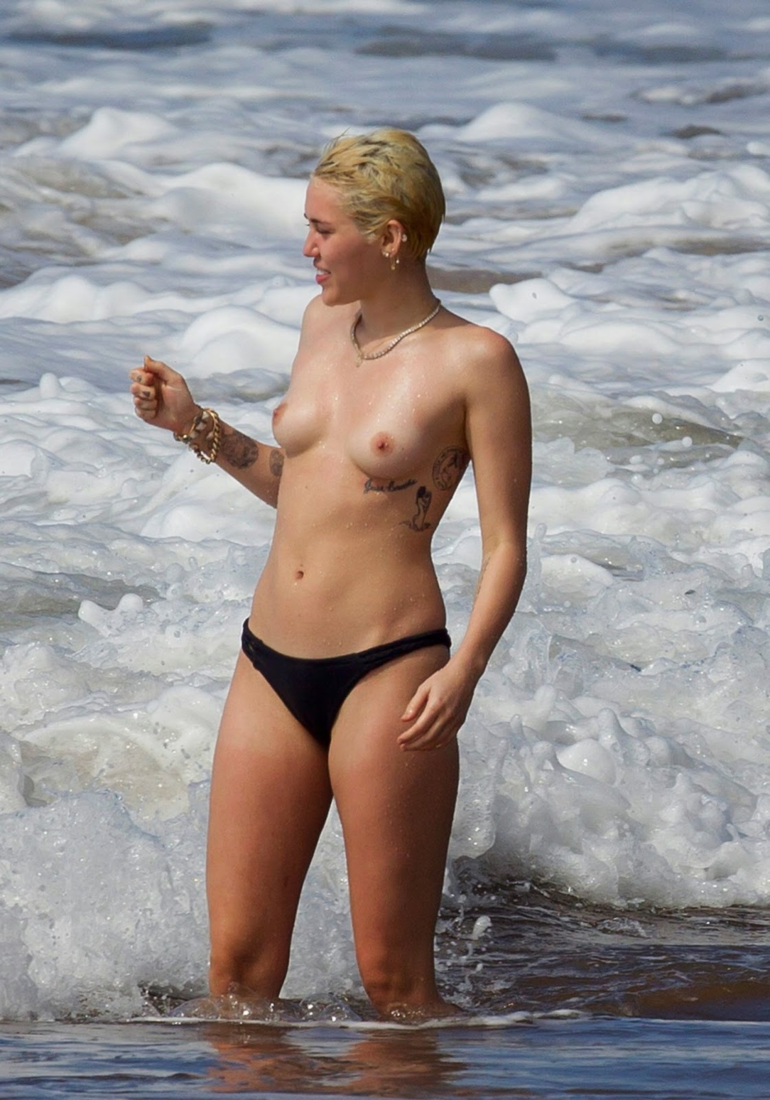 topless beach cyrus Miley