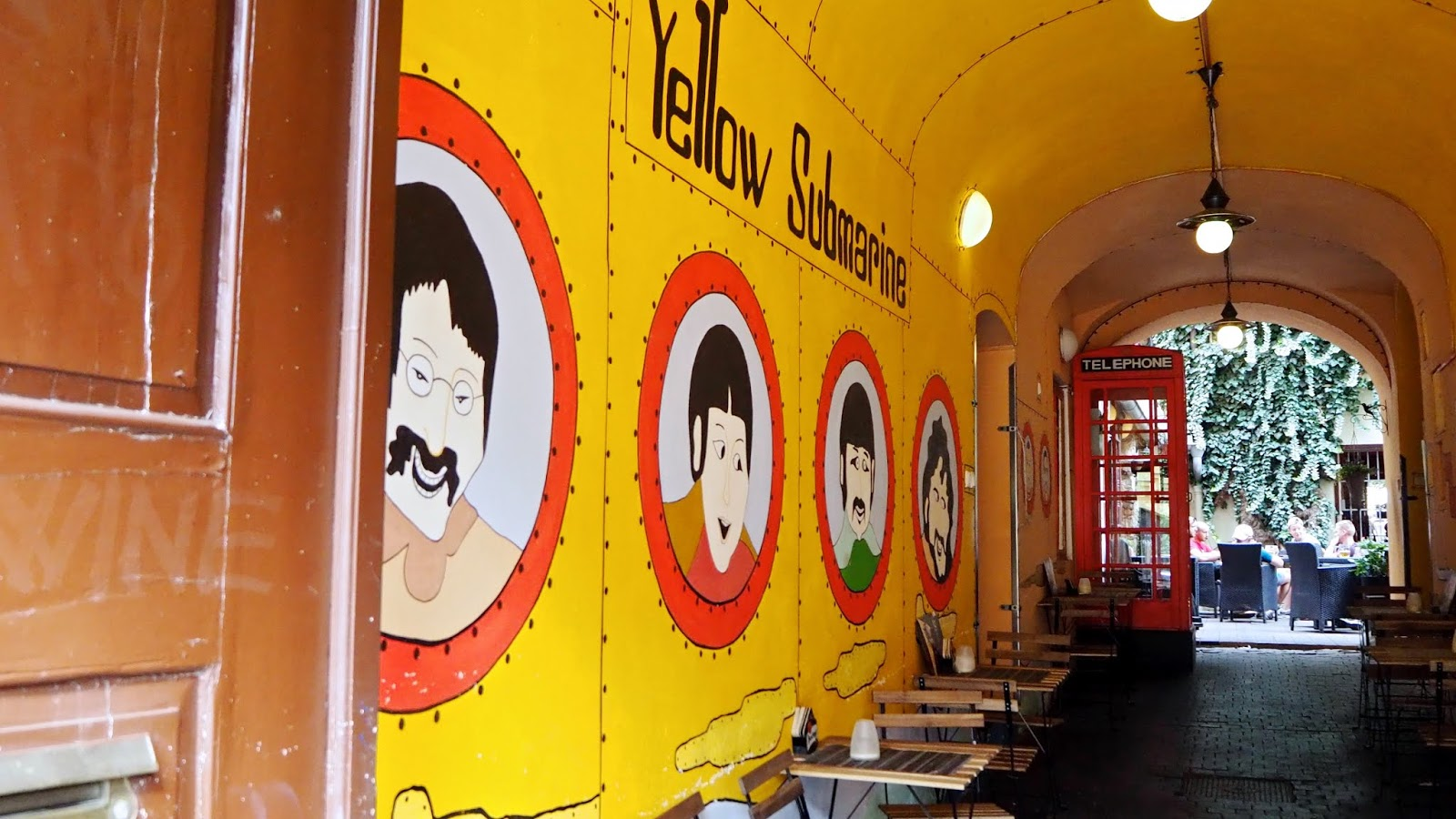 Yellow Submarine wall mural and British red telephone box