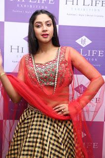 Angana Roy sizzles in Red Transparent Lehenga Choli at Hi Life Exhibition Launch