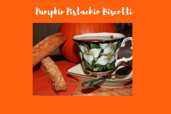 these are pumpkin biscotti Italian cookie with pistachio . They are  on a green and white flowered bup with a demitasse spoon of espresso coffee