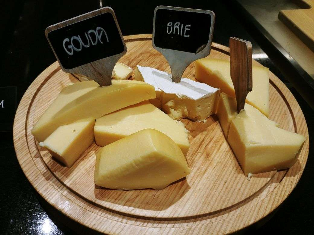 Cheese board with various cheese choices at The Grand Kitchen