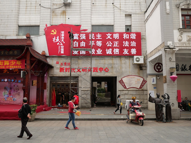 man completing a sign of China's 12 core socialist values