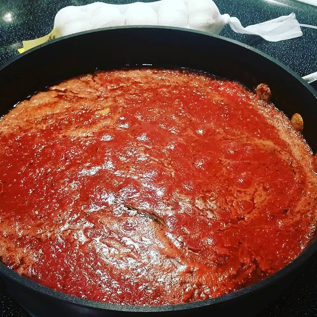 this is how to make traditional Tomato Italian Sauce for any kind of pasta in a large sauce pan filled with tomatoes for Thanksgiving