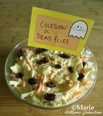 Coleslaw with raisins added to look like dead flies