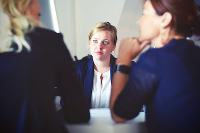 a woman at a business meeting looking stressed