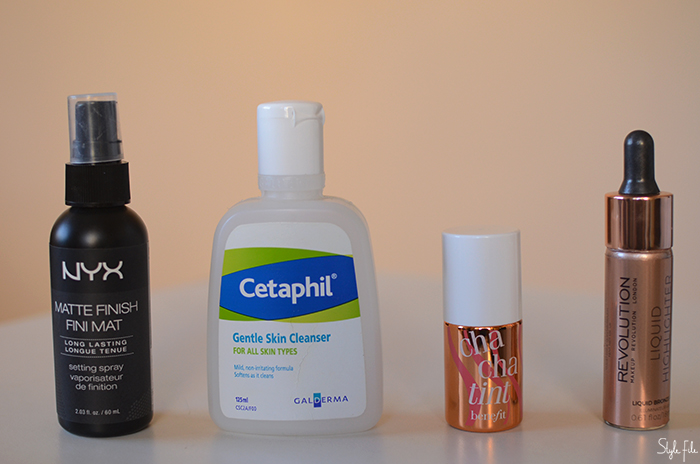 An image of Cetaphil gentle skin cleanser, NYX matte finish setting spray, Benefit cha cha tint and Makeup Revolution liquid illuminator in front of a peach background for a beauty review