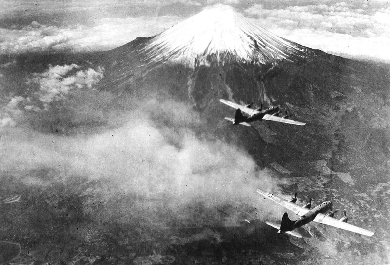 A formation of Boeing B-29 Superfortresses of the 73rd Bomb Wing fly over Mt. Fuji, Japan in 1945.