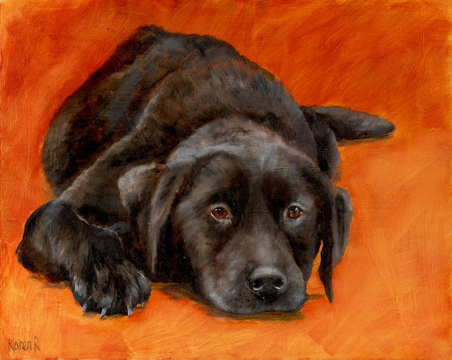 black labrador on an orange background